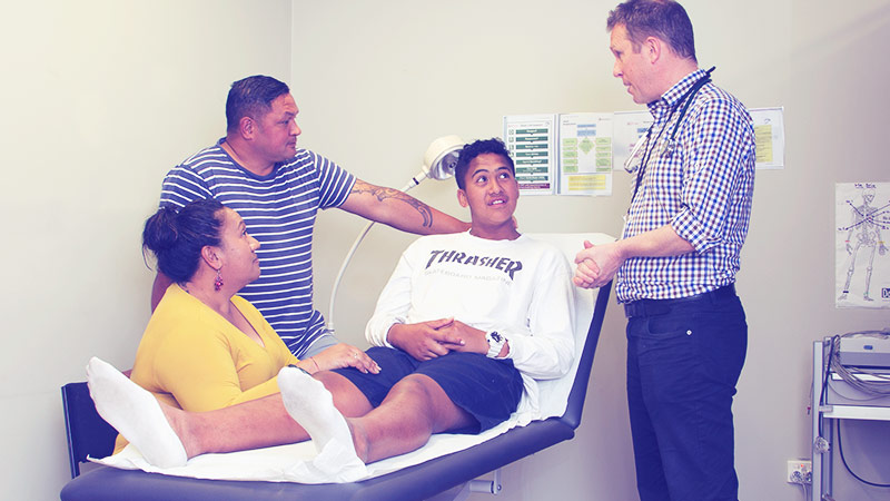 Teenage boy and family having a consultation with doctor